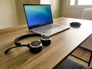 desk with headphones, laptop and mouse